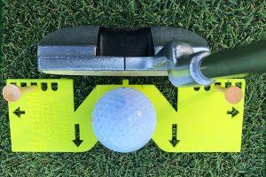 golf putting swing aid